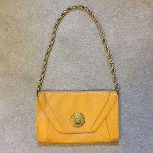 Elliott Lucca canary yellow clutch hand bag